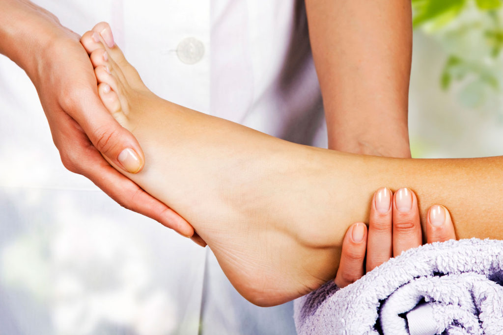 Hands cradling foot